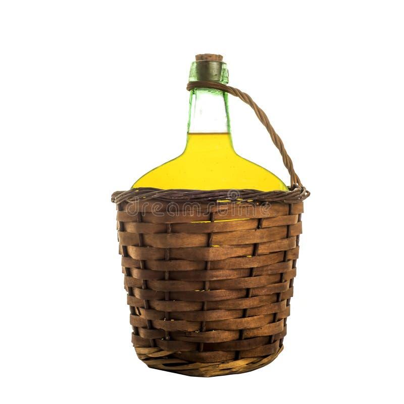 Olivenöl im alten Glasballon lokalisiert lizenzfreies stockbild