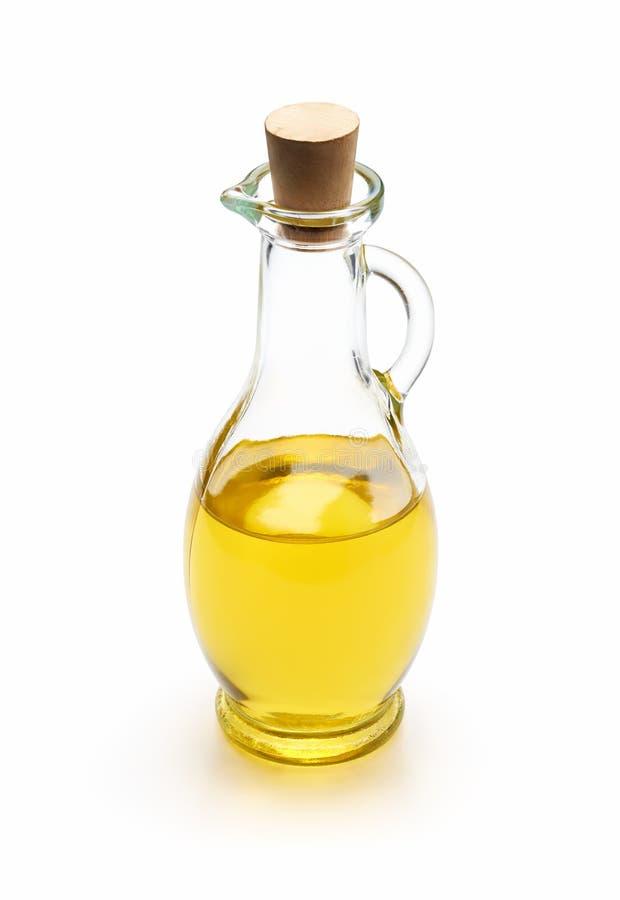 Oliven?l in einer Glasflasche lokalisiert auf wei?em Hintergrund lizenzfreies stockfoto