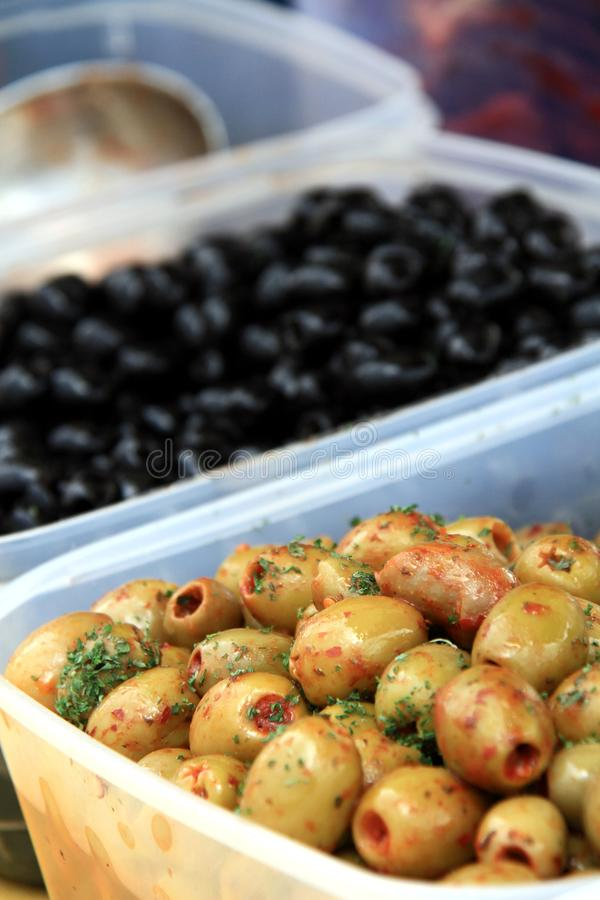 Olives. Image of fresh black and green olives in oil royalty free stock image