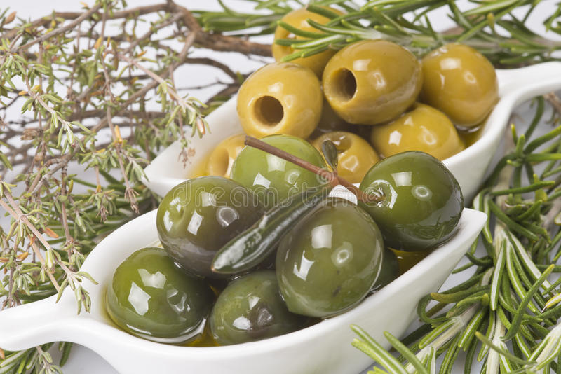 Olives and aromatic herbs stock images