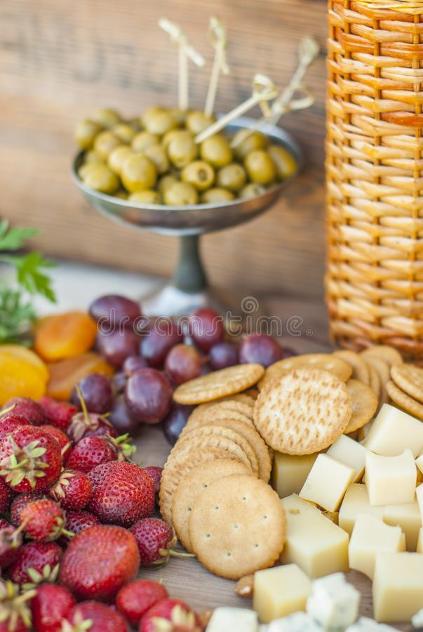 Olives and fruits on a beautifully vintage decorated table. Outdoor reception stock image