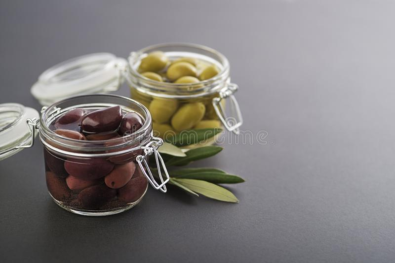 Black and green Olives in jar royalty free stock images