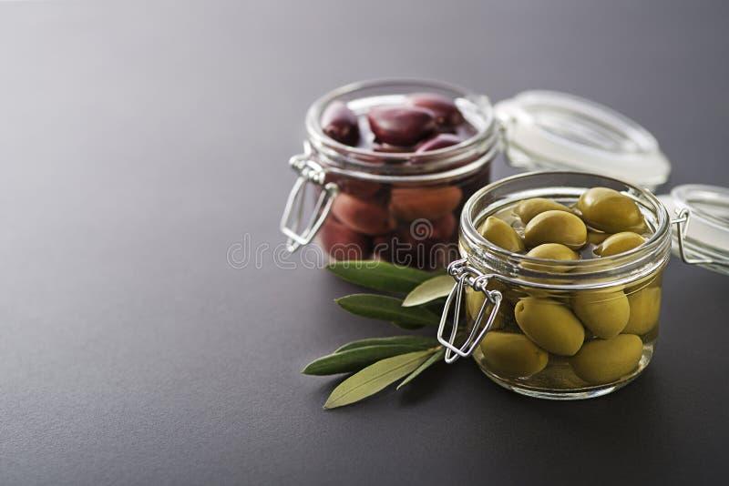 Pickled Olives in jar stock photo