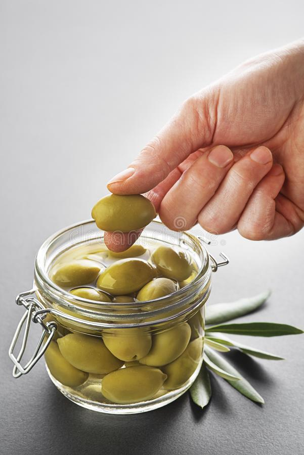 Olives fruit in jar royalty free stock photo