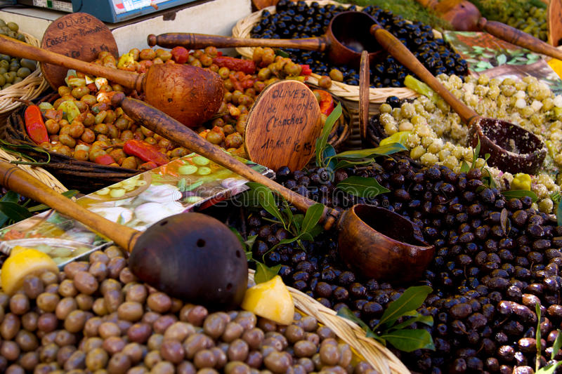 Olives on a Market stall. Baskets of green & black olives on a Provencal Market stall stock images