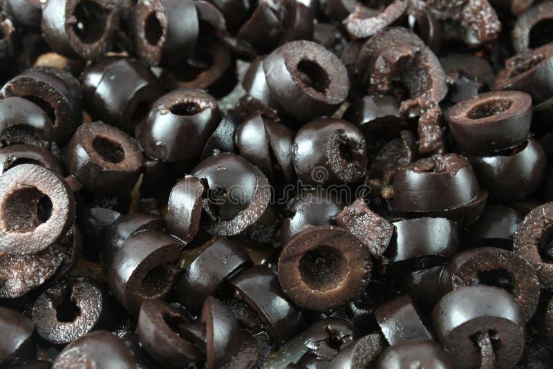 Olives noires coupées en tranches image stock