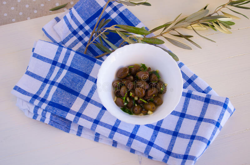 Olives and olive branch. Still life with olives and olive branch stock photography