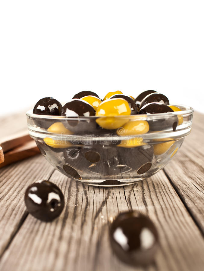 Download Olives on a wooden table stock photo. Image of fruits - 22956288