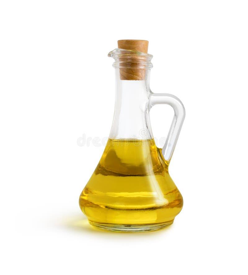 Olivgrön grönsakolja i kannan som isoleras med den snabba banan arkivbild