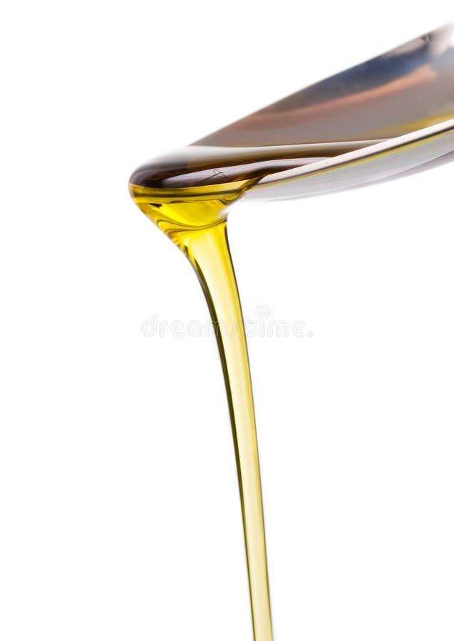 Olivolja och sked fotografering för bildbyråer