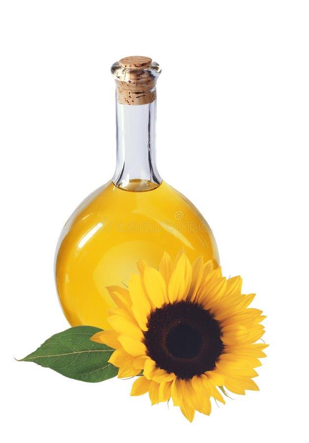 Oliwi w butelce i słoneczniku odizolowywających na bielu, zdjęcia stock