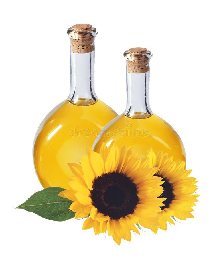 Oliwi w butelkach i słonecznikach odizolowywających na bielu, zdjęcie royalty free