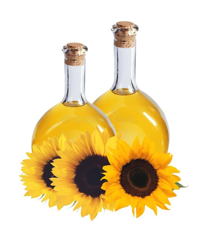 Oliwi w butelkach i słonecznikach odizolowywających na bielu, fotografia stock