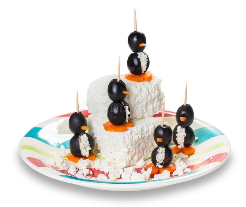 Oliwki faszerować z serem w postaci pingwinów obraz royalty free