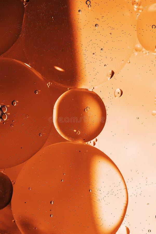 Olja tappar på en bevattna ytbehandlar fotografering för bildbyråer