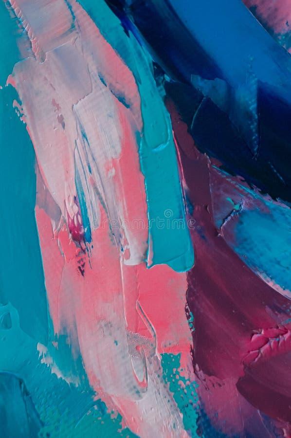 Oljamålarfärg på kanfas är skriftlig vid palettkniven Closeup av en målning vid olja- och palettkniven på kanfas arkivbild