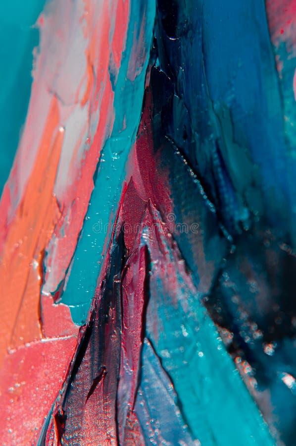 Oljamålarfärg på kanfas är skriftlig vid palettkniven Closeup av en målning vid olja- och palettkniven på kanfas arkivfoto