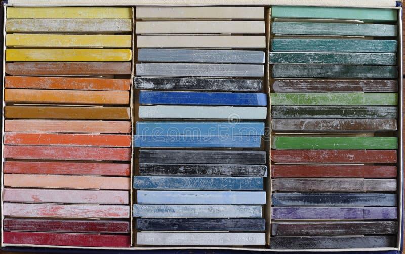 Olje- chalks i ask arkivbild