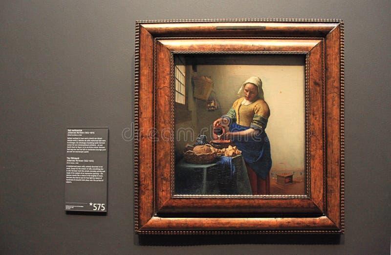 Olje- målning av mjölkerskan av Johannes Vermeer i Rijksmuseum, arkivfoto