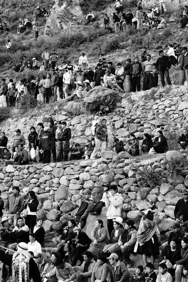 Ollantayambo Peruvian People. Peruvians watching bullfight at Ollantayambo Peruvian Sacred Valley royalty free stock photos