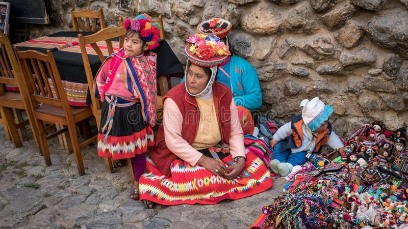 Portrait of an unidentified Peruvian Woman with her children in Native Clothing in Ollantaytambo, Peru stock photos