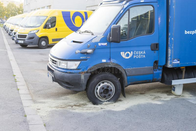 Olomouc Czech Rep 24th July 2019 Czech Post Office car with leaked diesel from a breatched tank. Old rusty Iveco daily. With modern yellow vans in background royalty free stock image