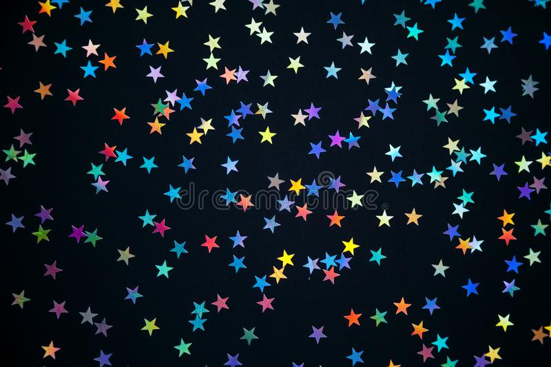 Olorful stars on a black background stock image