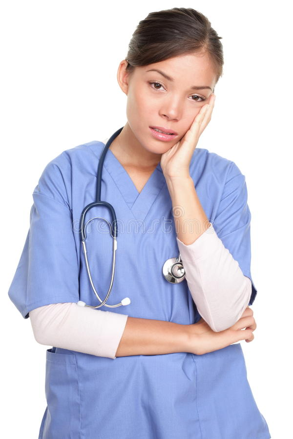 Olycklig kvinnlig kirurgdoktor eller sjuksköterska arkivbild