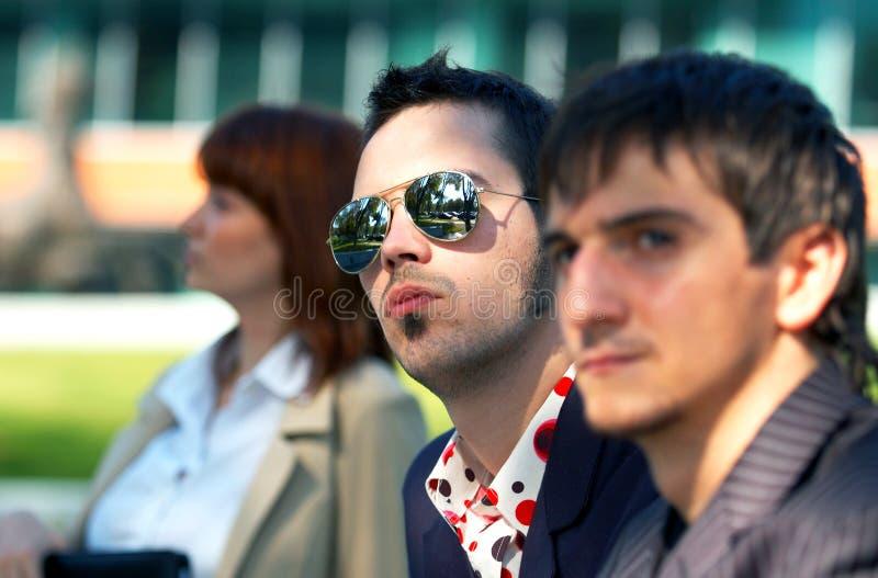 olycklig trio för 2 affär royaltyfria foton