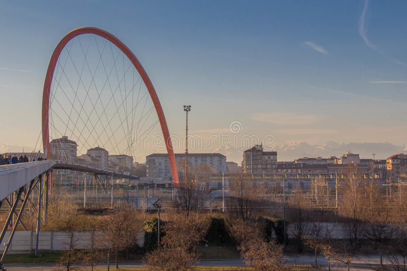 Olympic Arch of Turin. Buildings and white mountains on background. Lingotto district. Turino. Italy. stock images