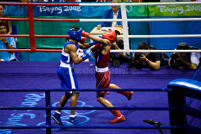 Olympic boxer lands punch royalty free stock photos