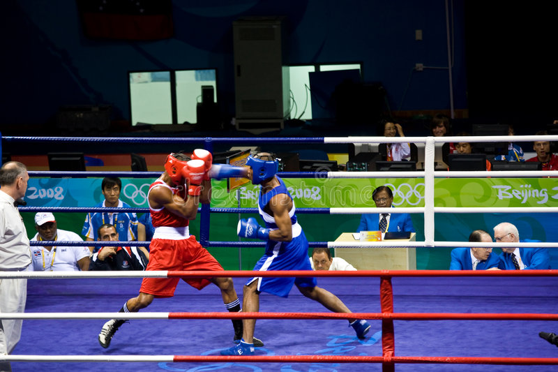 Olympic Boxing Punch. Boxer Argenis Nunez of the Dominican Republic punches Alfonso Blanco Parra of Venezuela during Olympics in Beijing China. Alfonso Blanco stock photography
