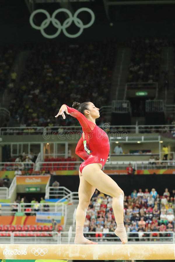 Olympic champion Aly Raisman of United States competes on the balance beam at women`s all-around gymnastics at Rio 2016 Olympics. RIO DE JANEIRO, BRAZIL - AUGUST stock images