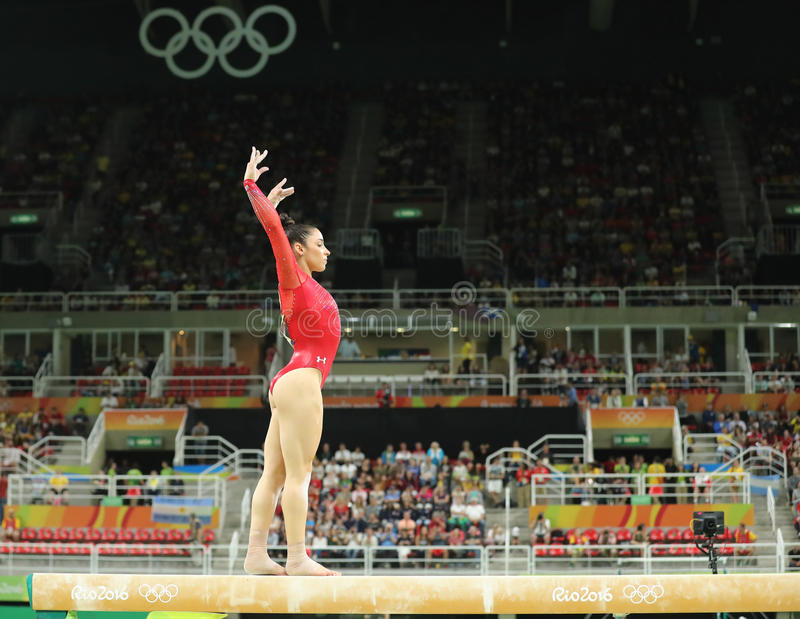 Olympic champion Aly Raisman of United States competes on the balance beam at women`s all-around gymnastics at Rio 2016 Olympics. RIO DE JANEIRO, BRAZIL - AUGUST stock photography