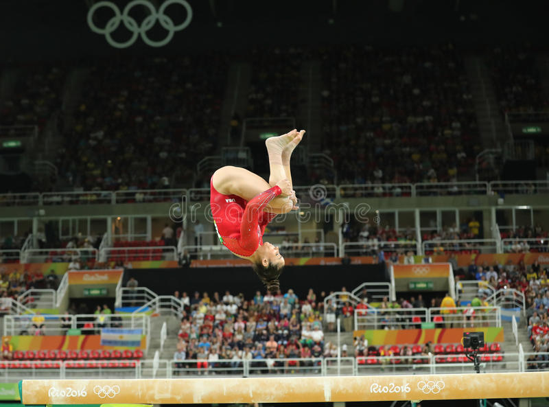Olympic champion Aly Raisman of United States competes on the balance beam at women`s all-around gymnastics at Rio 2016 Olympics. RIO DE JANEIRO, BRAZIL - AUGUST royalty free stock image