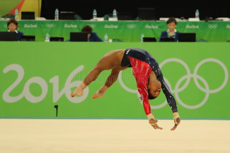 Olympic champion Gabby Douglas of United States competes on the floor exercise during women`s all-around gymnastics qualification. RIO DE JANEIRO, BRAZIL royalty free stock photo