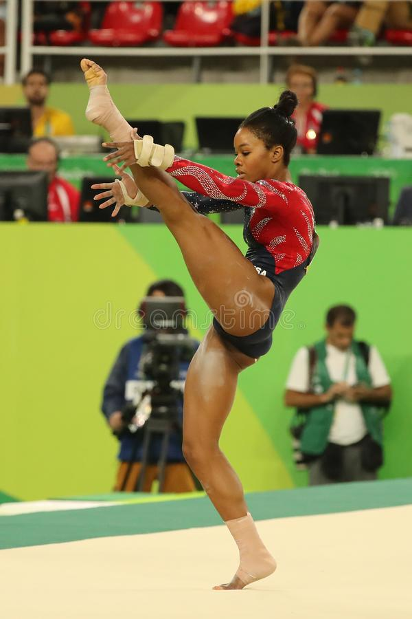 Olympic champion Gabby Douglas of United States competes on the floor exercise during women`s all-around gymnastics qualification. RIO DE JANEIRO, BRAZIL stock photos