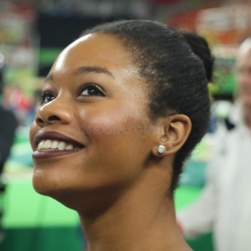 Olympic champion Gabby Douglas of United States competing at team women's all-around gymnastics at Rio 2016 Olympic Games. RIO DE JANEIRO, BRAZIL - AUGUST 9 royalty free stock photo