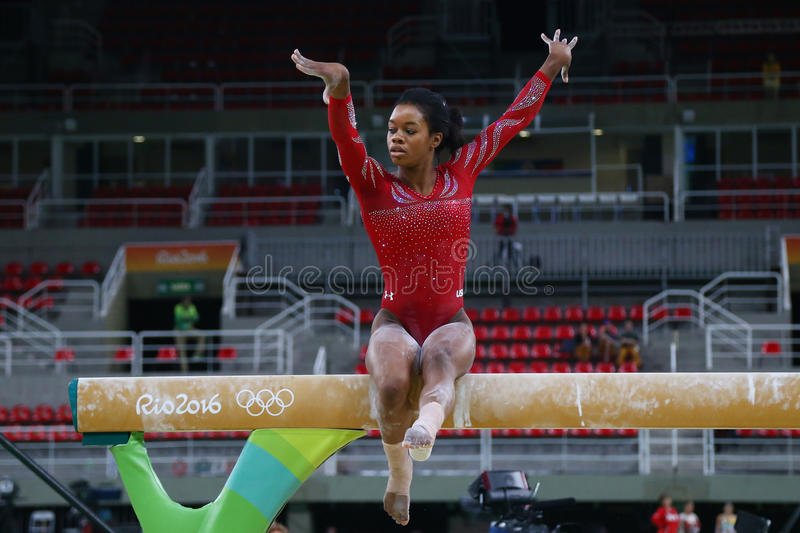 Olympic champion Gabby Douglas of United States practices on the balance beam before women`s all-around gymnastics at Rio 2016. RIO DE JANEIRO, BRAZIL AUGUST 4 stock photography