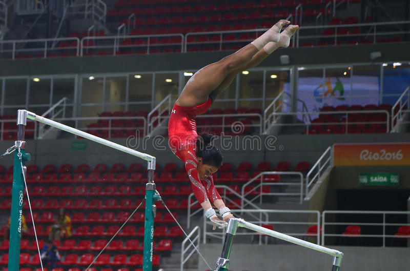 Olympic champion Gabby Douglas of United States practices on the uneven bars before women`s all-around gymnastics at Rio 2016. RIO DE JANEIRO, BRAZIL AUGUST 4 stock photography