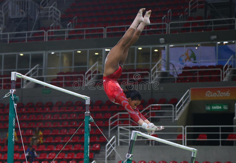 Olympic champion Gabby Douglas of United States practices on the uneven bars before women`s all-around gymnastics at Rio 2016. RIO DE JANEIRO, BRAZIL AUGUST 4 stock images