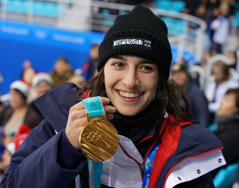 Olympic champion in Ladies` Moguls Perrine Laffont of France posing with gold medal royalty free stock photography