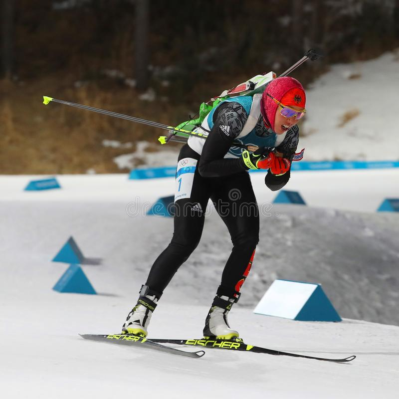 Olympic champion Laura Dahlmeier of Germany competes in biathlon women`s 10 km pursuit at the 2018 Winter Olympics. PYEONGCHANG, SOUTH KOREA - FEBRUARY 12, 2018 stock photo