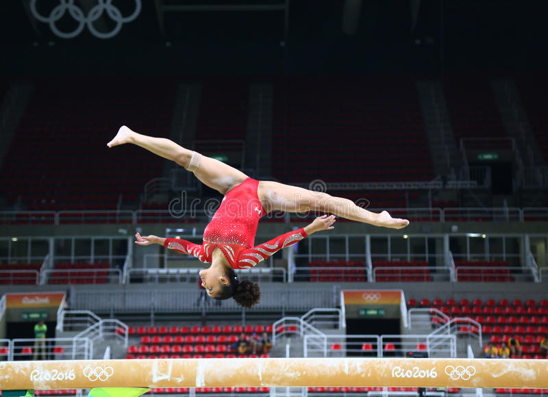 Olympic champion Laurie Hernandez of United States practices on the balance beam before women`s all-around gymnastics at Rio 2016. RIO DE JANEIRO, BRAZIL stock images