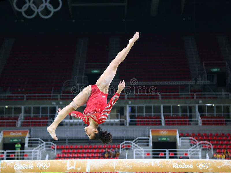 Olympic champion Laurie Hernandez of United States practices on the balance beam before women`s all-around gymnastics at Rio 2016. RIO DE JANEIRO, BRAZIL royalty free stock photos