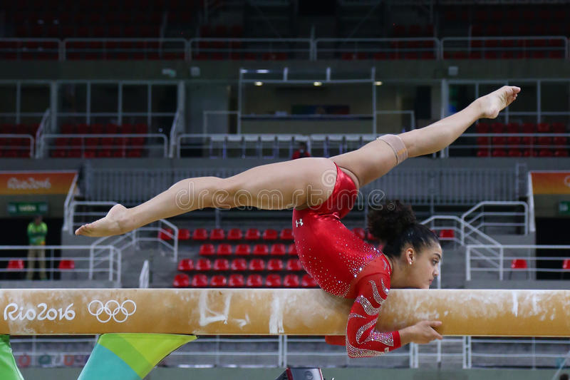 Olympic champion Laurie Hernandez of United States practices on the balance beam before women`s all-around gymnastics at Rio 2016. RIO DE JANEIRO, BRAZIL royalty free stock photo