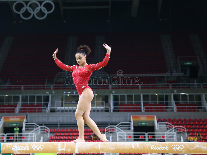 Olympic champion Laurie Hernandez of United States practices on the balance beam before women`s all-around gymnastics at Rio 2016. RIO DE JANEIRO, BRAZIL stock photos