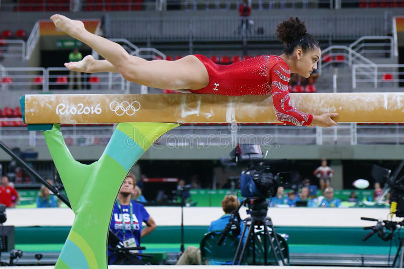 Olympic champion Laurie Hernandez of United States practices on the balance beam before women`s all-around gymnastics at Rio 2016. RIO DE JANEIRO, BRAZIL royalty free stock images