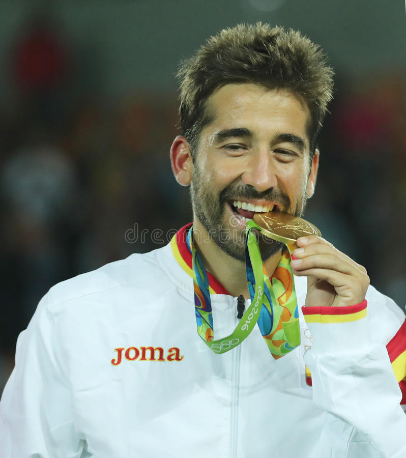 Olympic champion Mark Lopez of Spain during medal ceremony after victory at men`s doubles final of the Rio 2016. RIO DE JANEIRO, BRAZIL - AUGUST 12, 2016 royalty free stock photo