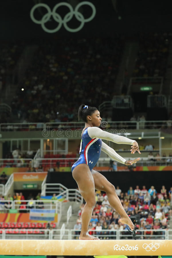 Olympic champion Simone Biles of United States competes on the balance beam at women`s all-around gymnastics at Rio 2016. RIO DE JANEIRO, BRAZIL - AUGUST 11 royalty free stock photo